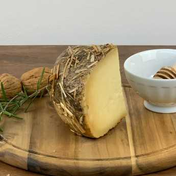 <h5>Pecorino Cheese Aged Under Straw And Hay.</h5>