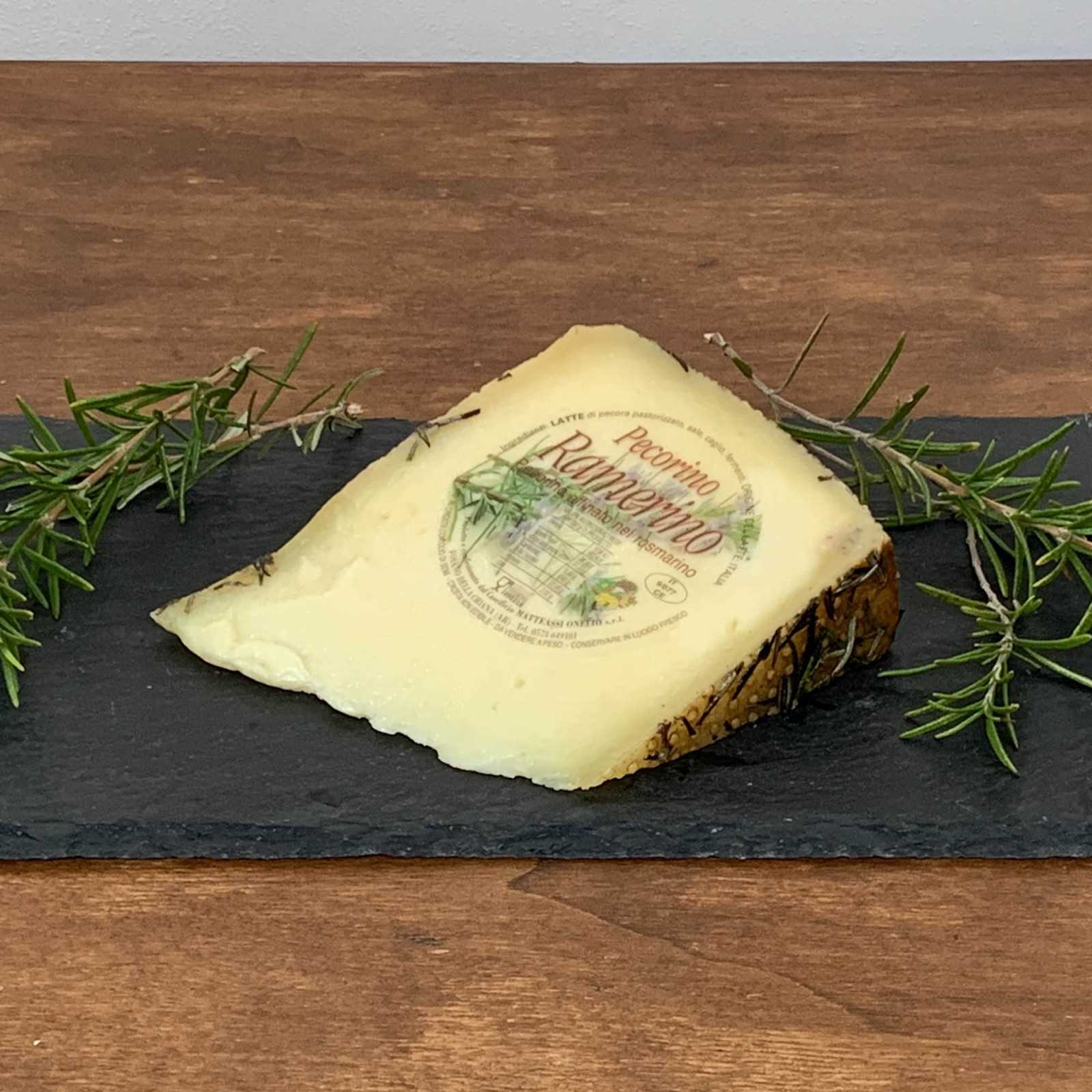 Pecorino Cheese Aged Under Rosemary Leaves.