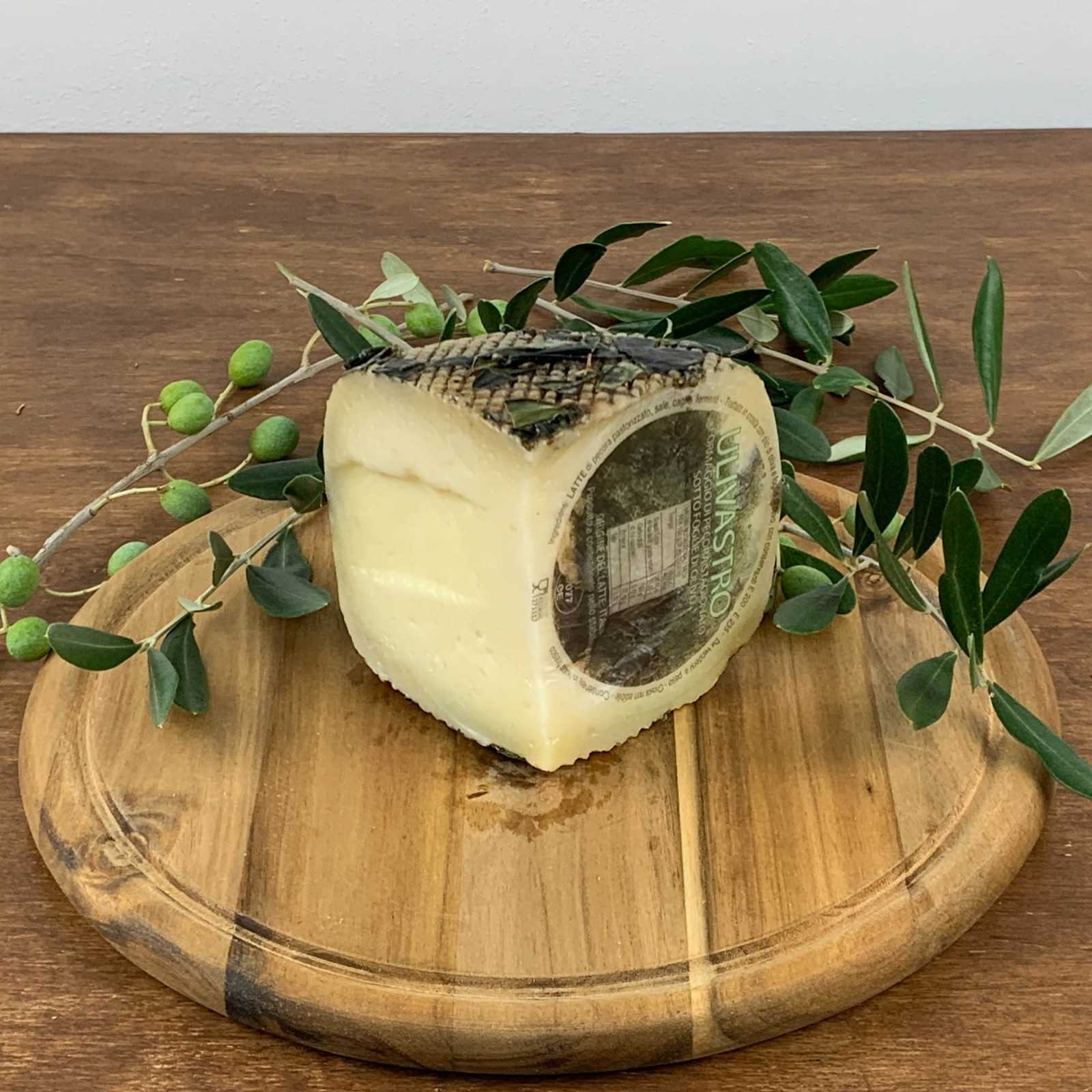 Pecorino Cheese Aged Under Olive Leaves.