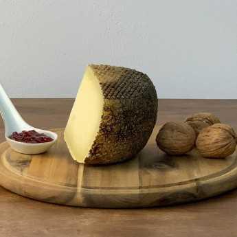 "<h5>""Rigatello"" Aged Tuscan Pecorino Cheese.</h5>"